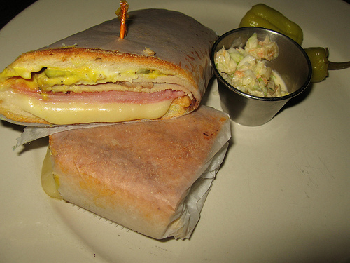 Cuban Sandwitch made of Roast pork, ham, Swiss cheese, pickles, garlic mayo & mustard